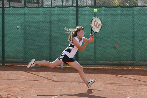 Fully engaged tennis player steps beyond fear of failure