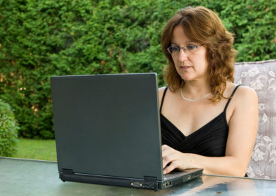 mature woman participating in mentor coaching video cofnerence