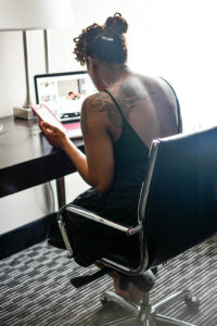 Black woman working at a laptop